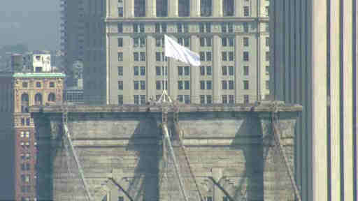 "<div class=""meta image-caption""><div class=""origin-logo origin-image ""><span></span></div><span class=""caption-text"">Two American Flags that usually fly over the Brooklyn Bridge were replaced with white flags on July 22, 2014.</span></div>"