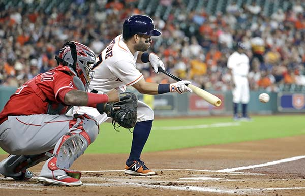 "<div class=""meta image-caption""><div class=""origin-logo origin-image ap""><span>AP</span></div><span class=""caption-text"">Houston Astros' Jose Altuve, right, bunts for a single as Los Angeles Angels catcher Martin Maldonado reaches for the pitch during the first inning  (AP Photo/David J. Phillip) (AP)</span></div>"
