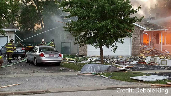 <div class='meta'><div class='origin-logo' data-origin='WLS'></div><span class='caption-text' data-credit='Debbie King'>More than 20 homes were damaged after a house explosion Sunday morning.</span></div>