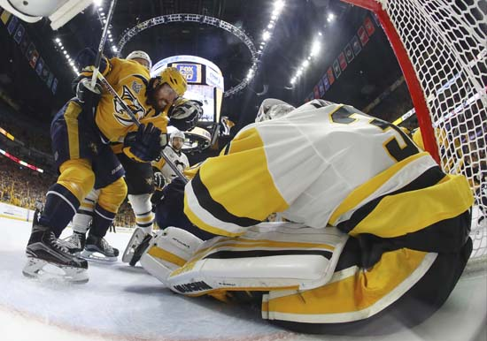"<div class=""meta image-caption""><div class=""origin-logo origin-image ap""><span>AP</span></div><span class=""caption-text"">Pittsburgh Penguins goalie Matt Murray defends the goal against Nashville Predators' James Neal (18) during the first period of Game 6. (Bruce Bennett/Pool Photo via AP) (AP)</span></div>"