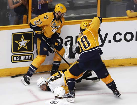 "<div class=""meta image-caption""><div class=""origin-logo origin-image ap""><span>AP</span></div><span class=""caption-text"">Pittsburgh Penguins' Trevor Daley (6) falls as he battles for the puck against Nashville Predators' Colin Wilson (33) and James Neal (18). (AP Photo/Jeff Roberson) (AP)</span></div>"