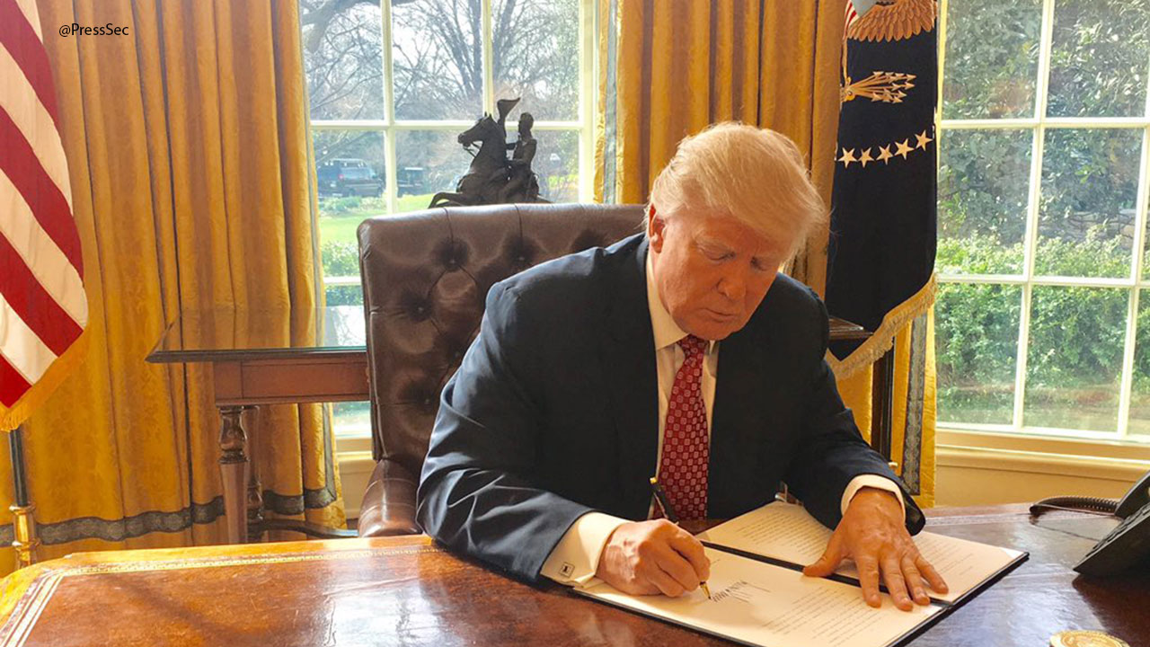 President Trump on Monday, March 2, 2017, signs a new travel ban that will temporarily halt entry to the U.S. for those from six Muslim-majority nations who are seeking new visas.