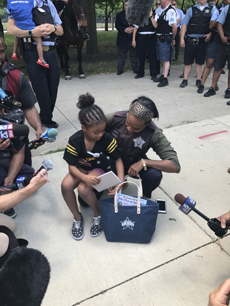 <div class='meta'><div class='origin-logo' data-origin='WLS'></div><span class='caption-text' data-credit=''>Rosalyn Baldwin met with members of the Chicago Police Department on Monday. The 7-year old is on a mission to hug police officers in every state.</span></div>