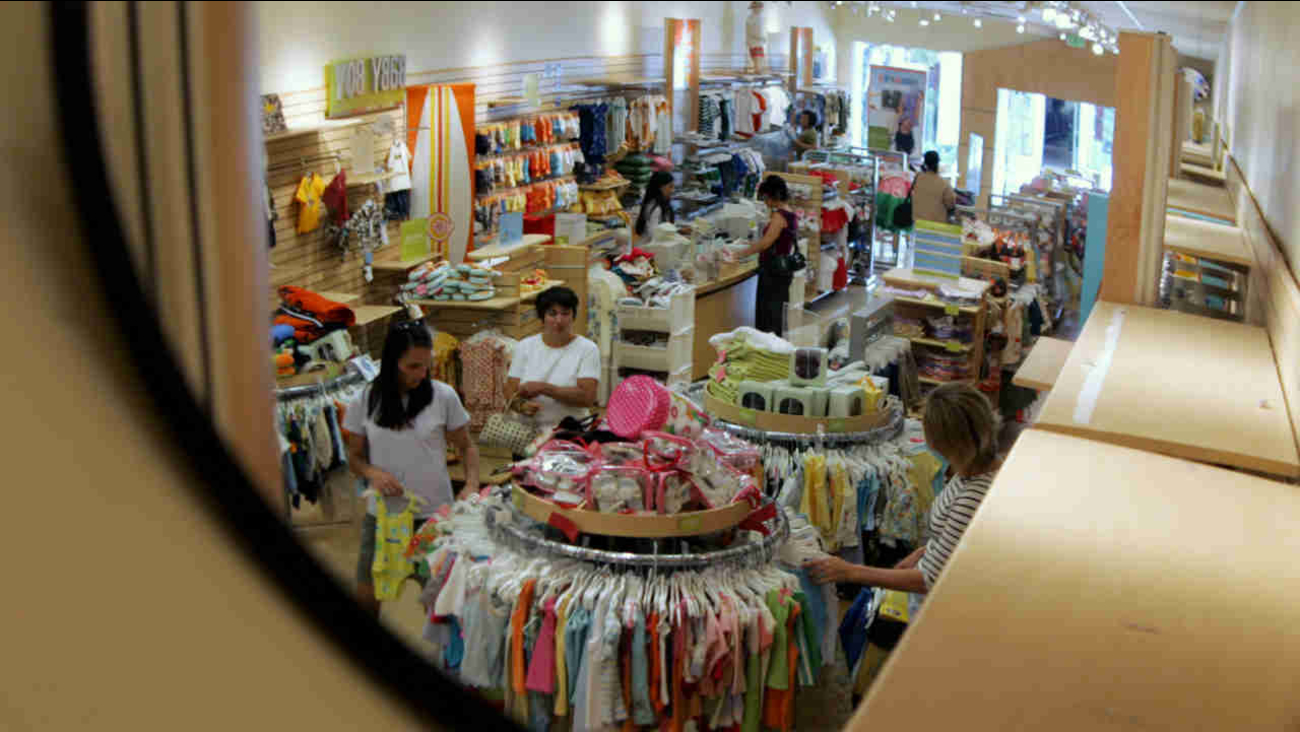 A security mirror shows shoppers at a Gymboree store at Stanford Shopping Center in Palo Alto, Calif., Wednesday, July 6, 2005.