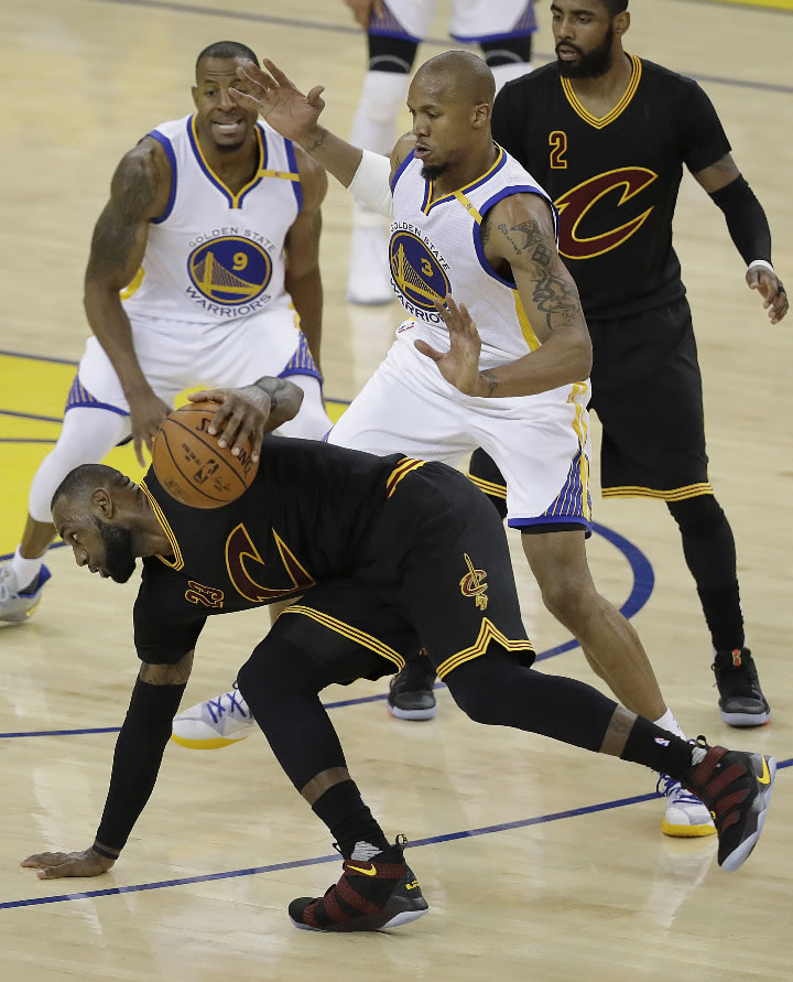 <div class='meta'><div class='origin-logo' data-origin='none'></div><span class='caption-text' data-credit='AP Photo/Marcio Jose Sanchez'>Cavs forward LeBron James, bottom, dribbles against Warriors forward Andre Iguodala (9) and forward David West (3) during the NBA Finals in Oakland, Calif., Monday, June 12, 2017.</span></div>