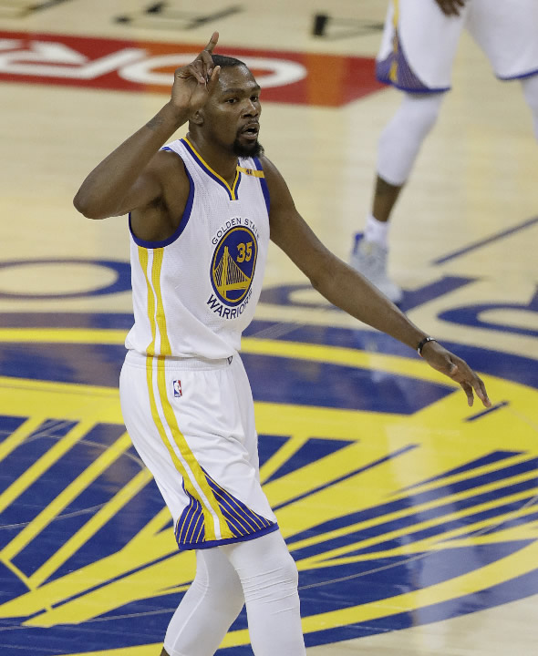 <div class='meta'><div class='origin-logo' data-origin='none'></div><span class='caption-text' data-credit='AP Photo/Marcio Jose Sanchez'>Warriors forward Kevin Durant (35) gestures after scoring against the Cavaliers during the first half of Game 5 of basketball's NBA Finals in Oakland, Calif., Monday, June 12, 2017</span></div>