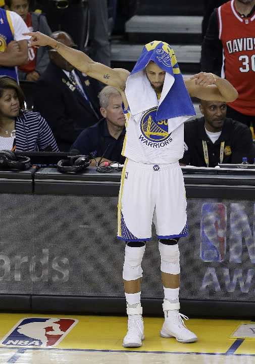 """<div class=""""meta image-caption""""><div class=""""origin-logo origin-image none""""><span>none</span></div><span class=""""caption-text"""">Warriors guard Stephen Curry (30) gestures during the first half of Game 5 of basketball's NBA Finals against the Cavaliers in Oakland, Calif., Monday, June 12, 2017. (AP Photo/Ben Margot)</span></div>"""