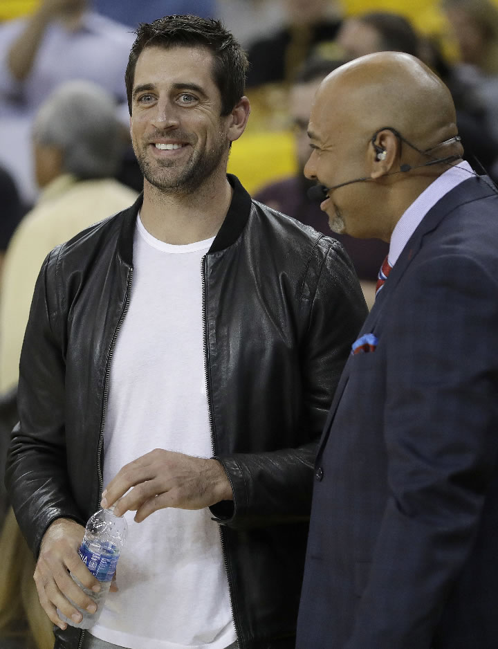 <div class='meta'><div class='origin-logo' data-origin='none'></div><span class='caption-text' data-credit='AP Photo/Marcio Jose Sanch'>Green Bay Packers quarterback Aaron Rodgers, left, laughs with Michael Wilbon before Game 5 of the NBA Finals in Oakland, Calif., Monday, June 12, 2017.</span></div>