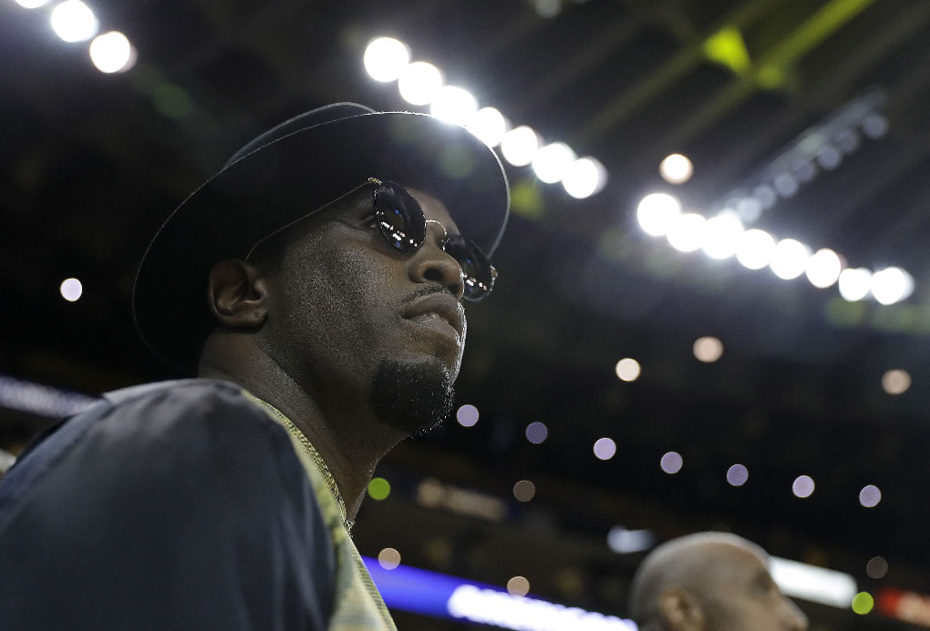 <div class='meta'><div class='origin-logo' data-origin='none'></div><span class='caption-text' data-credit='AP Photo/Marcio Jose Sanchez'>Musician Sean &#34;Diddy&#34; Combs watches as players warm up before Game 5 of the NBA Finals in Oakland, Calif., Monday, June 12, 2017.</span></div>