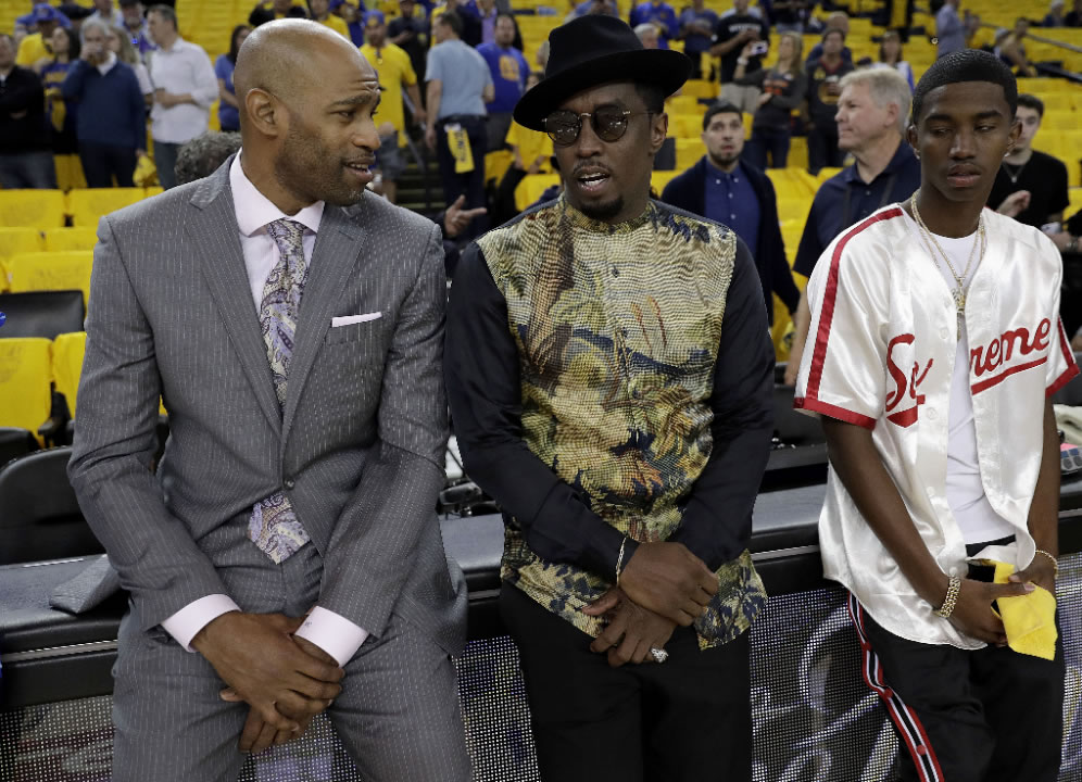"<div class=""meta image-caption""><div class=""origin-logo origin-image none""><span>none</span></div><span class=""caption-text"">Vince Carter, left, talks with musician Sean ""Diddy"" Combs, center, before Game 5 of the NBA Finals in Oakland, Calif., Monday, June 12, 2017. (AP Photo/Marcio Jose Sanchez)</span></div>"