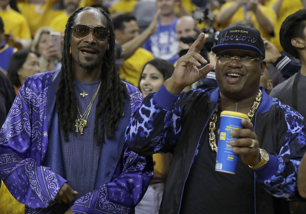 <div class='meta'><div class='origin-logo' data-origin='none'></div><span class='caption-text' data-credit='AP Photo/Marcio Jose Sanchez'>Musicians Snoop Dogg, left, and E-40 pose for photos before Game 5 of the NBA Finals in Oakland, Calif., Monday, June 12, 2017.</span></div>