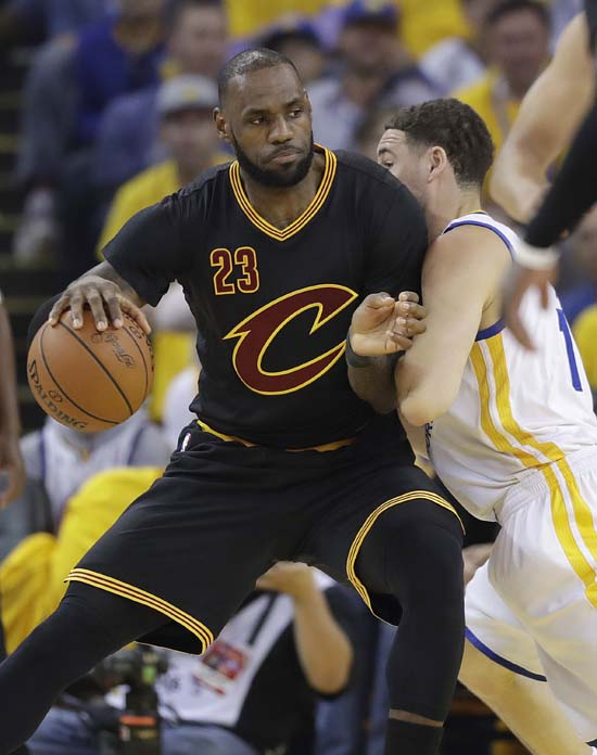 "<div class=""meta image-caption""><div class=""origin-logo origin-image ap""><span>AP</span></div><span class=""caption-text"">Cleveland Cavaliers forward LeBron James (23) dribbles against Golden State Warriors guard Klay Thompson during the first half. (AP Photo/Marcio Jose Sanchez) (AP)</span></div>"