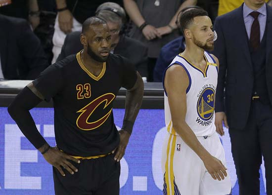 "<div class=""meta image-caption""><div class=""origin-logo origin-image ap""><span>AP</span></div><span class=""caption-text"">Cleveland Cavaliers forward LeBron James (23) and Golden State Warriors guard Stephen Curry (30) during the first half. (AP Photo/Ben Margot) (AP)</span></div>"
