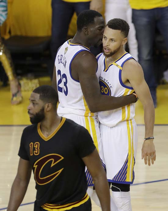 "<div class=""meta image-caption""><div class=""origin-logo origin-image ap""><span>AP</span></div><span class=""caption-text"">Golden State Warriors forward Draymond Green (23) talks with guard Stephen Curry (30) behind Cleveland Cavaliers center Tristan Thompson (13). (AP Photo/Marcio Jose Sanchez) (AP)</span></div>"