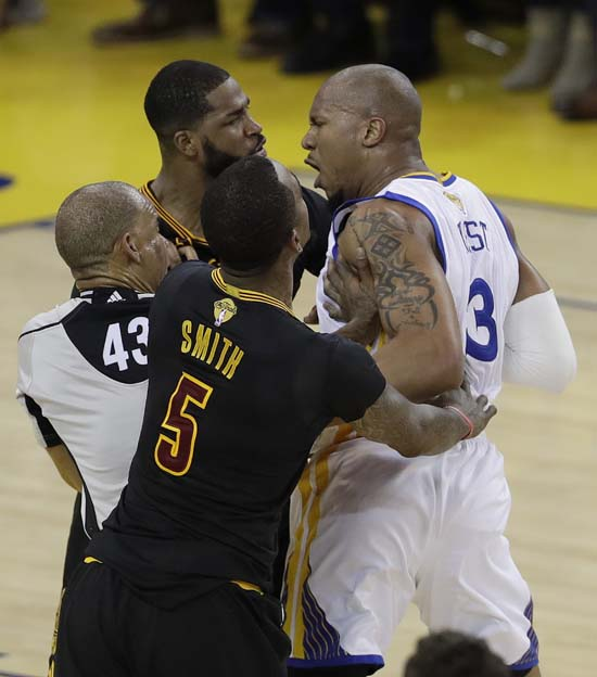 "<div class=""meta image-caption""><div class=""origin-logo origin-image ap""><span>AP</span></div><span class=""caption-text"">Cavaliers center Tristan Thompson, top left, and Warriors forward David West (3) are separated by guard J.R. Smith (5) and referee Dan Crawford. (AP Photo/Marcio Jose Sanchez) (AP)</span></div>"