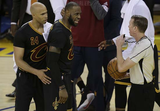 "<div class=""meta image-caption""><div class=""origin-logo origin-image ap""><span>AP</span></div><span class=""caption-text"">Cleveland Cavaliers forward LeBron James, center, and forward Richard Jefferson (24) talk with referee Ed Malloy during the first half. (AP Photo/Ben Margot) (AP)</span></div>"