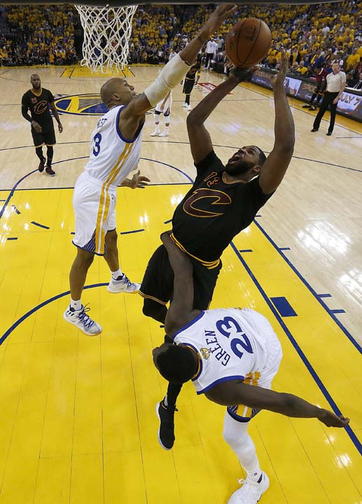 "<div class=""meta image-caption""><div class=""origin-logo origin-image ap""><span>AP</span></div><span class=""caption-text"">Cavaliers center Tristan Thompson (13) shoots between Warriors forward David West (3) and forward Draymond Green (23) during the first half. (AP Photo/Marcio Jose Sanchez, Pool) (AP)</span></div>"