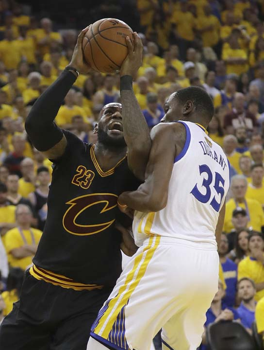 "<div class=""meta image-caption""><div class=""origin-logo origin-image ap""><span>AP</span></div><span class=""caption-text"">Cleveland Cavaliers forward LeBron James (23) shoots against Golden State Warriors forward Kevin Durant (35) during the second half. (AP Photo/Marcio Jose Sanchez) (AP)</span></div>"