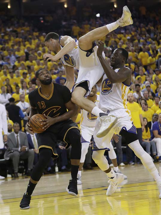 "<div class=""meta image-caption""><div class=""origin-logo origin-image ap""><span>AP</span></div><span class=""caption-text"">Cavaliers center Tristan Thompson (13) shoots again Warriors guard Klay Thompson, top, and forward Draymond Green during the second half. (AP Photo/Marcio Jose Sanchez) (AP)</span></div>"