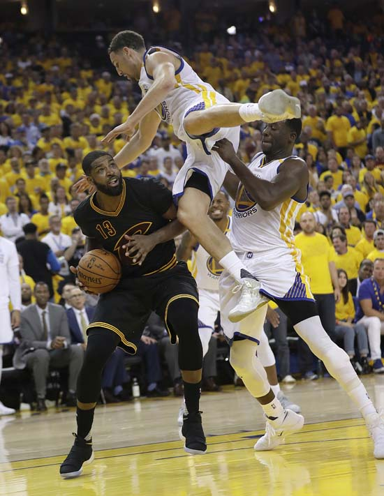 "<div class=""meta image-caption""><div class=""origin-logo origin-image ap""><span>AP</span></div><span class=""caption-text"">Cleveland Cavaliers center Tristan Thompson (13) shoots again Golden State Warriors guard Klay Thompson, top, and forward Draymond Green. (AP Photo/Marcio Jose Sanchez) (AP)</span></div>"