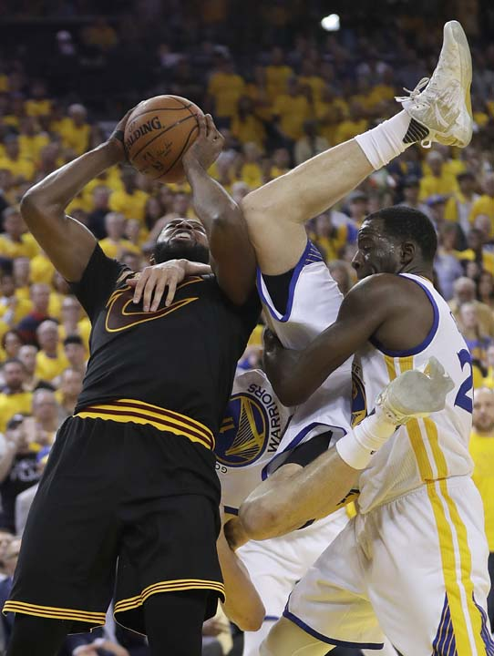 "<div class=""meta image-caption""><div class=""origin-logo origin-image ap""><span>AP</span></div><span class=""caption-text"">Cleveland Cavaliers center Tristan Thompson, left, shoots as Golden State Warriors guard Klay Thompson, center, is held by forward Draymond Green. (AP Photo/Marcio Jose Sanchez) (AP)</span></div>"