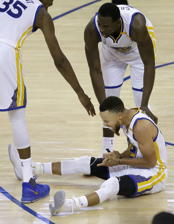 <div class='meta'><div class='origin-logo' data-origin='none'></div><span class='caption-text' data-credit=''>Warriors guard Stephen Curry reacts under forward Kevin Durant (35) and forward Draymond Green during the second half of Game 5 of the NBA Finals in Oakland, Calif., June 12, 2017.</span></div>