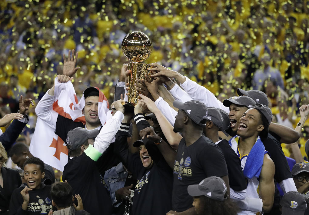 <div class='meta'><div class='origin-logo' data-origin='none'></div><span class='caption-text' data-credit='AP Photo/Marcio Jose Sanchez'>Warriors players, coaches and owners hold up the Larry O'Brien NBA Championship Trophy after Game 5 of the NBA Finals in Oakland, Calif., Monday, June 12, 2017.</span></div>