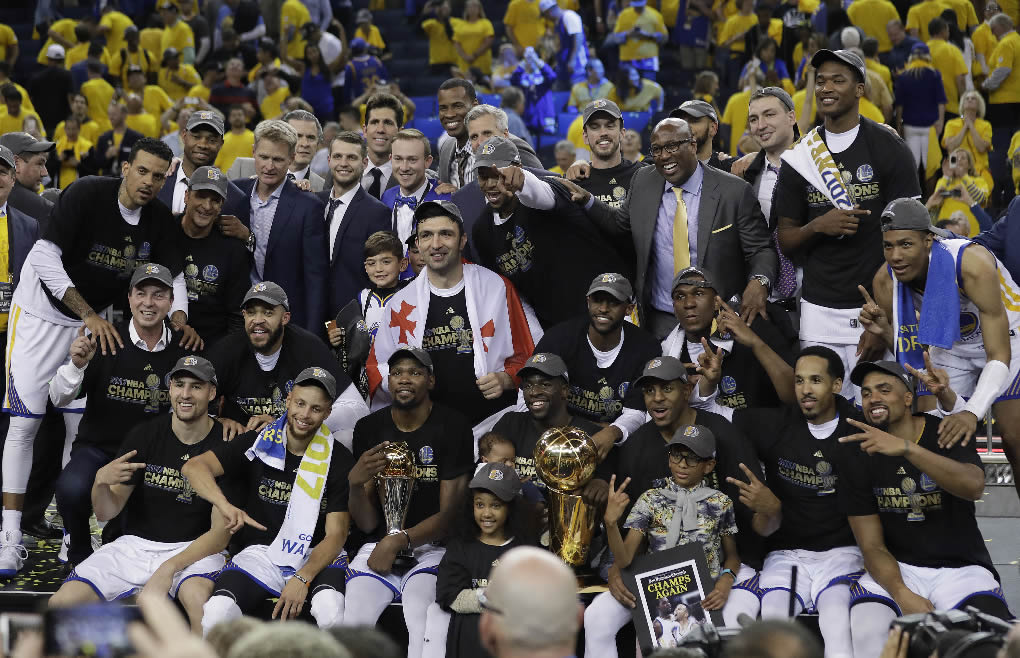 """<div class=""""meta image-caption""""><div class=""""origin-logo origin-image none""""><span>none</span></div><span class=""""caption-text"""">Warriors players, coaches and owners pose for photos after Game 5 of the NBA Finals against the Cavaliers in Oakland, Calif., Monday, June 12, 2017. (AP Photo/Marcio Jose Sanchez)</span></div>"""