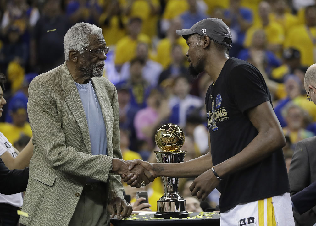 """<div class=""""meta image-caption""""><div class=""""origin-logo origin-image none""""><span>none</span></div><span class=""""caption-text"""">Warriors forward Kevin Durant, right, shakes hands with Bill Russell as he is presented the Bill Russell NBA Finals Most Valuable Player Award in Oakland, Calif. on June 12, 2017. (AP Photo/Marcio Jose Sanchez)</span></div>"""