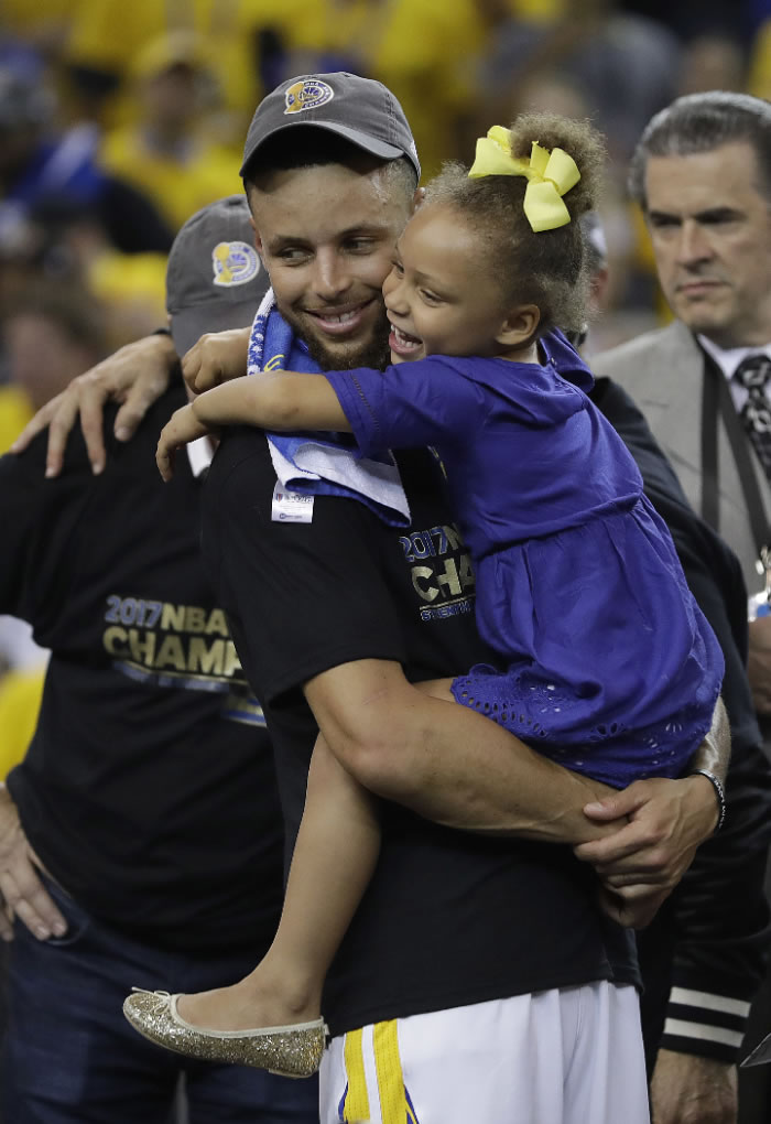 <div class='meta'><div class='origin-logo' data-origin='none'></div><span class='caption-text' data-credit='AP Photo/Marcio Jose Sanchez'>Warriors guard Stephen Curry hugs his daughter Riley after Game 5 of the NBA Finals in Oakland, Calif., Monday, June 12, 2017.</span></div>