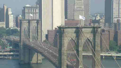 "<div class=""meta image-caption""><div class=""origin-logo origin-image ""><span></span></div><span class=""caption-text"">Aluminum foil pans were used to cover up lights when suspects changed out the flags that fly over the Brooklyn Bridge.</span></div>"