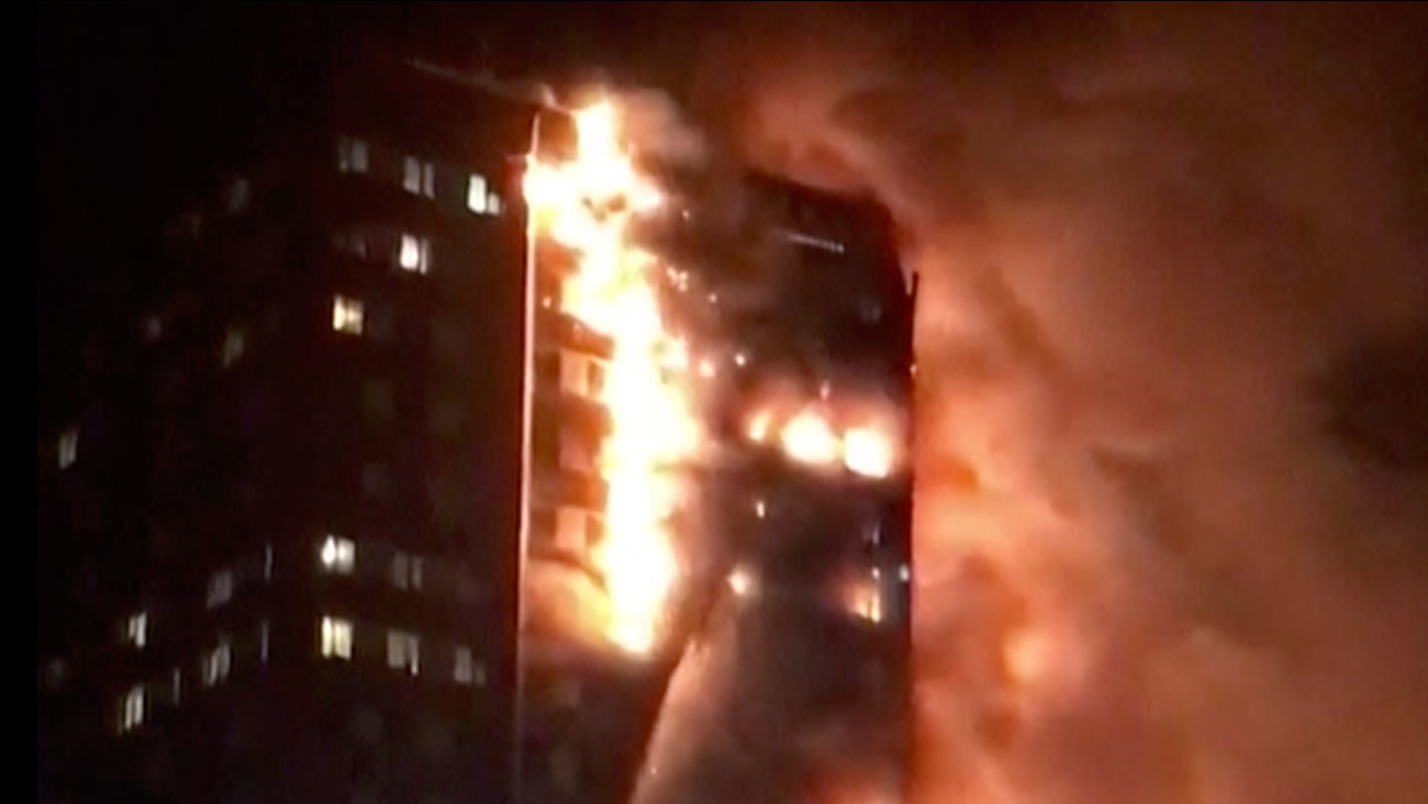 In this image made from video provided by Celeste Thomas @MAMAPIE, a high-rise building is on fire in London, Wednesday, June 14, 2017