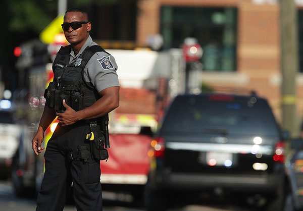 <div class='meta'><div class='origin-logo' data-origin='none'></div><span class='caption-text' data-credit='Alex Wong/Getty Images'>A member of the Alexandria Police stands guard near the scene of an opened fire June 14, 2017 in Alexandria, Virginia. Multiple injuries were reported from the instance.</span></div>