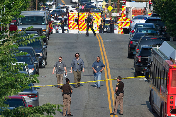 <div class='meta'><div class='origin-logo' data-origin='none'></div><span class='caption-text' data-credit='Cliff Owen/AP Photo'>Police and emergency personnel are seen near the scene of a shooting during a Congressional baseball practice in Alexandria, Va., Wednesday, June 14, 2017.</span></div>