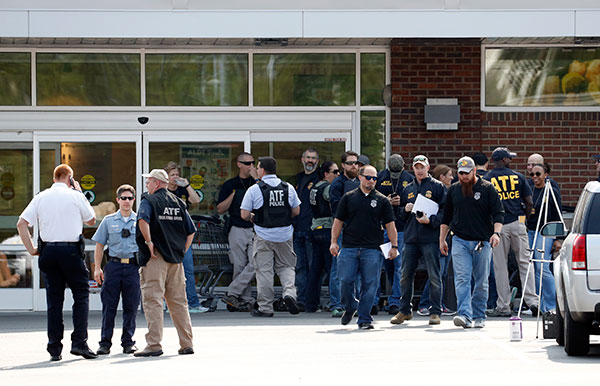 <div class='meta'><div class='origin-logo' data-origin='none'></div><span class='caption-text' data-credit='Alex Brandon/AP Photo'>Law enforcement officers gather near the scene of a shooting near a baseball field in Alexandria, Va., Wednesday, June 14, 2017.</span></div>