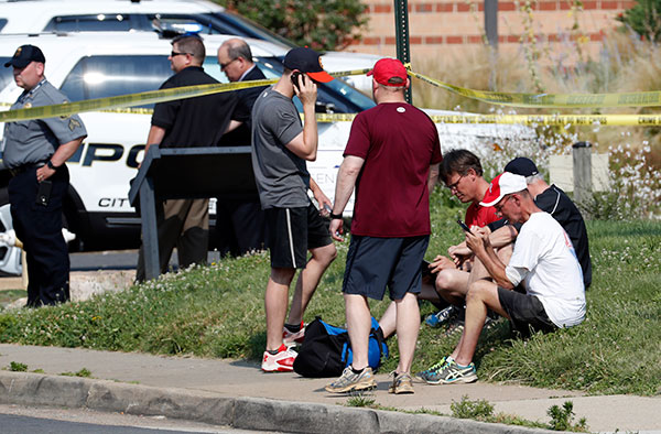 <div class='meta'><div class='origin-logo' data-origin='none'></div><span class='caption-text' data-credit='Alex Brandon/AP Photo'>People gather near the scene of a shooting near a baseball field in Alexandria, Va., Wednesday, June 14, 2017.</span></div>