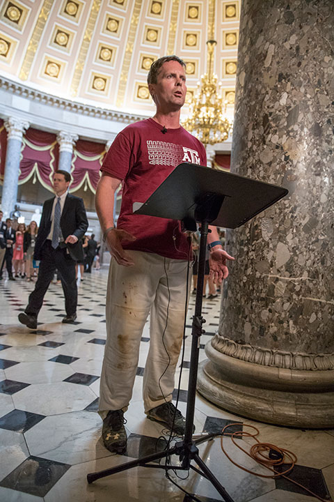 <div class='meta'><div class='origin-logo' data-origin='none'></div><span class='caption-text' data-credit='J. Scott Applewhite/AP Photo'>Rep. Rodney Davis, R-Ill., still wearing his baseball uniform, describes for reporters on Capitol Hill in Washington, Wednesday, June 14, 2017.</span></div>