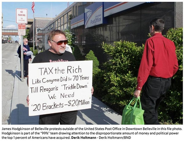 <div class='meta'><div class='origin-logo' data-origin='none'></div><span class='caption-text' data-credit='Derik Holtmann/Belleville News Democrat'>The Belleville News Democrat shared a photo of suspect James T. Hodgkinson protesting outside a Belleville, Ill. post office in 2012.</span></div>