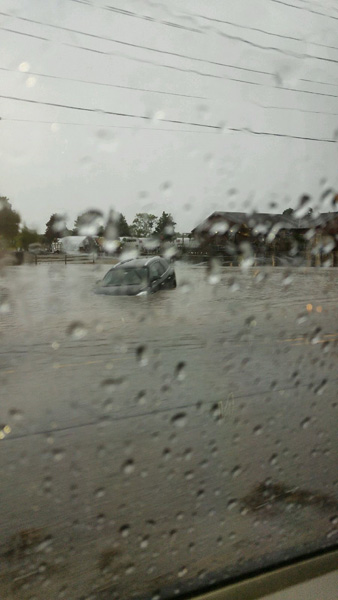 <div class='meta'><div class='origin-logo' data-origin='none'></div><span class='caption-text' data-credit=''>A car submerged in flood waters near Route 167 and Terra Cotta in Crystal Lake, Ill.</span></div>