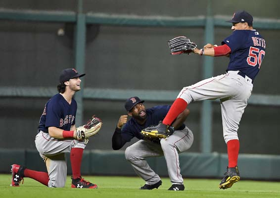 "<div class=""meta image-caption""><div class=""origin-logo origin-image ap""><span>AP</span></div><span class=""caption-text"">Boston Red Sox's Mookie Betts, right, celebrates the team's win over the Houston Astros with Andrew Benintendi, left, and Jackie Bradley Jr., center,(AP Photo/Eric Christian Smith) (AP)</span></div>"