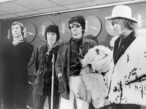 <div class='meta'><div class='origin-logo' data-origin='AP'></div><span class='caption-text' data-credit='AP Photo'>Four of the five members of the Rolling Stones, from left, Charlie Watts, Bill Wyman, Keith Richards, and Brian Jones, are shown at a news conference on their arrival at JFK.</span></div>
