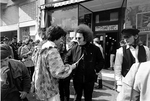 <div class='meta'><div class='origin-logo' data-origin='AP'></div><span class='caption-text' data-credit='AP Photo'>Two hippies talk on the crowded sidewalk in front of The Print Mint shop on Haight St. in San Francisco, Ca. on April 13, 1967.</span></div>