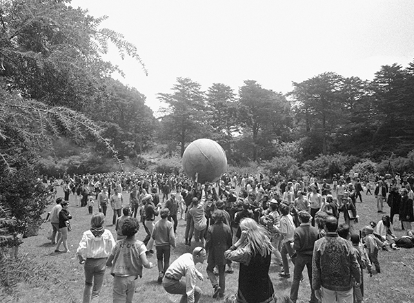 <div class='meta'><div class='origin-logo' data-origin='AP'></div><span class='caption-text' data-credit=''>A crowd keeps a large ball, painted to represent a world globe, in the air during a gathering at Golden Gate Park to celebrate the summer solstice.</span></div>