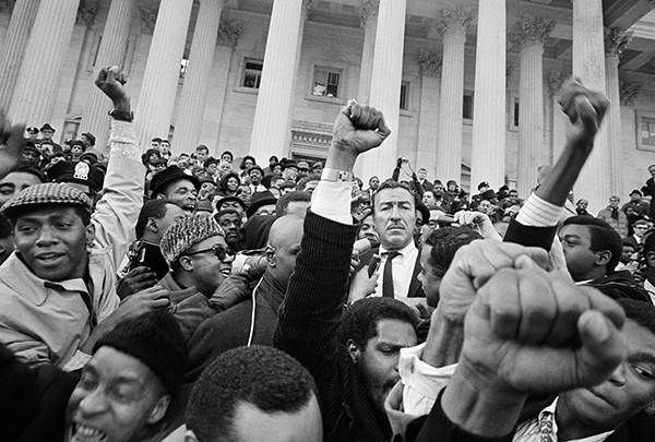 <div class='meta'><div class='origin-logo' data-origin='AP'></div><span class='caption-text' data-credit=''>Rep. Adam Clayton Powell stands amid a throng of supporters on the House steps of the U.S. Capitol building, Jan. 10, 1967, in Washington.</span></div>
