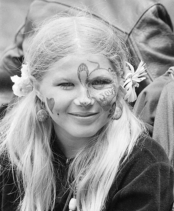 <div class='meta'><div class='origin-logo' data-origin='AP'></div><span class='caption-text' data-credit=''>In this Thursday, June 21, 1967 file photo, Judy Smith, wearing face paint and flowers in her hair, smiles as she and others gather at Golden Gate Park in San Francisco.</span></div>