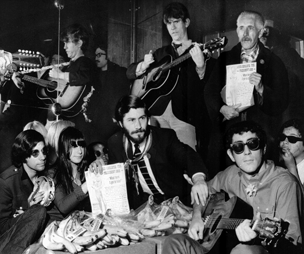 <div class='meta'><div class='origin-logo' data-origin='AP'></div><span class='caption-text' data-credit='AP Photo'>Bearded Louis Abolafia sits among bananas and guitar-playing hippies in a theater in the East Village of New York City, May 3, 1967.</span></div>