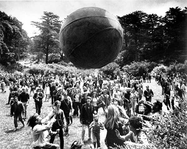 <div class='meta'><div class='origin-logo' data-origin='AP'></div><span class='caption-text' data-credit='AP Photo'>A crowd keeps a large ball, painted to represent a world globe, in the air during a gathering at Golden Gate Park to celebrate the summer solstice on Thursday, June 21, 1967.</span></div>