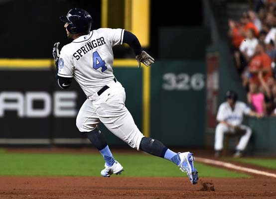 """<div class=""""meta image-caption""""><div class=""""origin-logo origin-image ap""""><span>AP</span></div><span class=""""caption-text"""">Houston Astros' George Springer runs to second after hitting a double during the first inning of a baseball game against the Boston Red Sox, (AP Photo/Eric Christian Smith) (AP)</span></div>"""