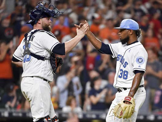 "<div class=""meta image-caption""><div class=""origin-logo origin-image ap""><span>AP</span></div><span class=""caption-text"">Houston Astros relief pitcher Dayan Diaz (38) and catcher Brian McCann clasp hands after their win over the Boston Red Sox (AP Photo/Eric Christian Smith) (AP)</span></div>"