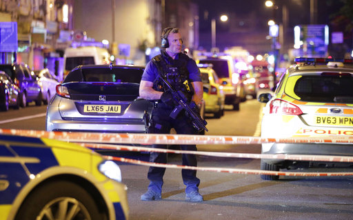 "<div class=""meta image-caption""><div class=""origin-logo origin-image ap""><span>AP</span></div><span class=""caption-text"">An armed police officer mans a cordon on the Seven Sisters Road at Finsbury Park where a vehicle struck pedestrians in London. ((Yui Mok/PA via AP))</span></div>"